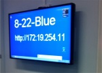 A blue screen points students to the web login for their group