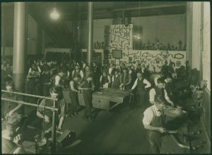 Students in plumbing workshop, Working Mens College