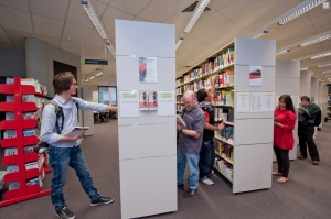 Students browse bookshelves at Carlton Library