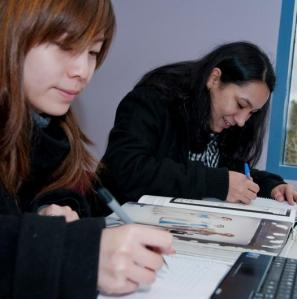 Two students studying at Brunswick Library