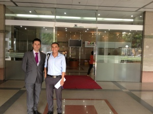 Greg and our Vietnamese interpreter Kevin outside Station HTV9