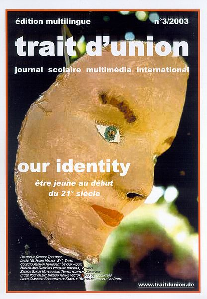 "Cover of International Multimedia School Magazine ""trait d'union"" n° 03-2003. Topic: ""our identity. Creator of the mask: Antonia Lent, German School of Toulouse (2003). Photographer: Lothar Thiel. Source: Wikimedia Commons"