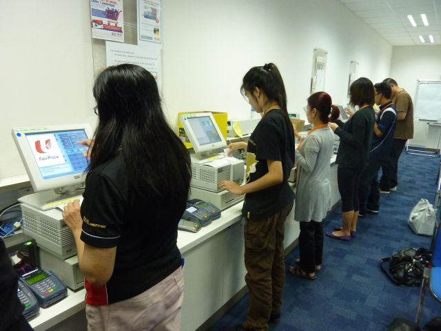 image depicting a session in a workplace training centre at a major Singapore supermarket chain.